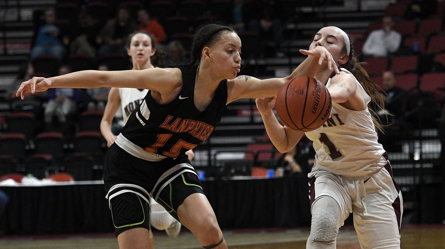 Montini's Sophie Sullivan and Lanphier's Lezhauria Williams go after a loose ball in the Class 3A state girls basketball finals in Normal.