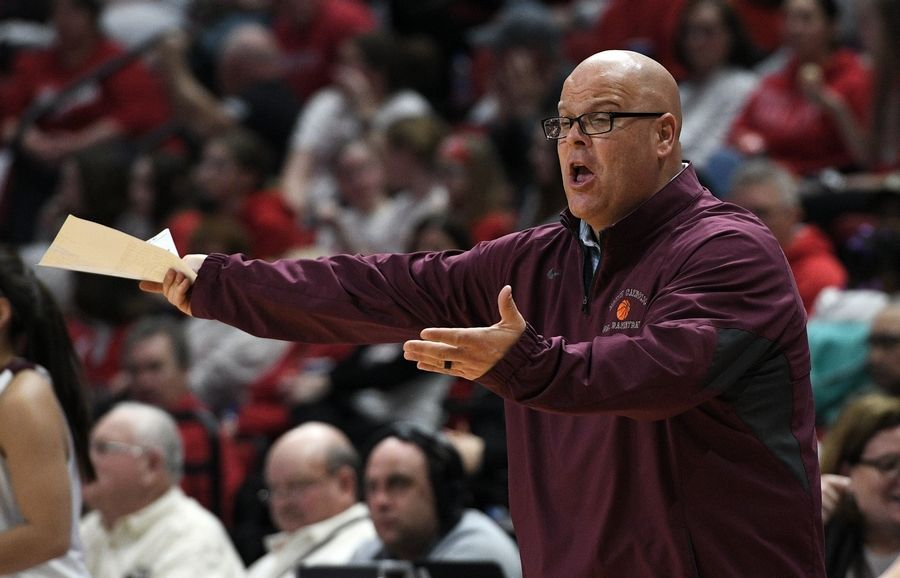 Montini's coach Jason Nichols expresses himself in the final seconds of their third place win over Lanphier with the final score 55-43 in the Class 3A state girls basketball finals in Normal.