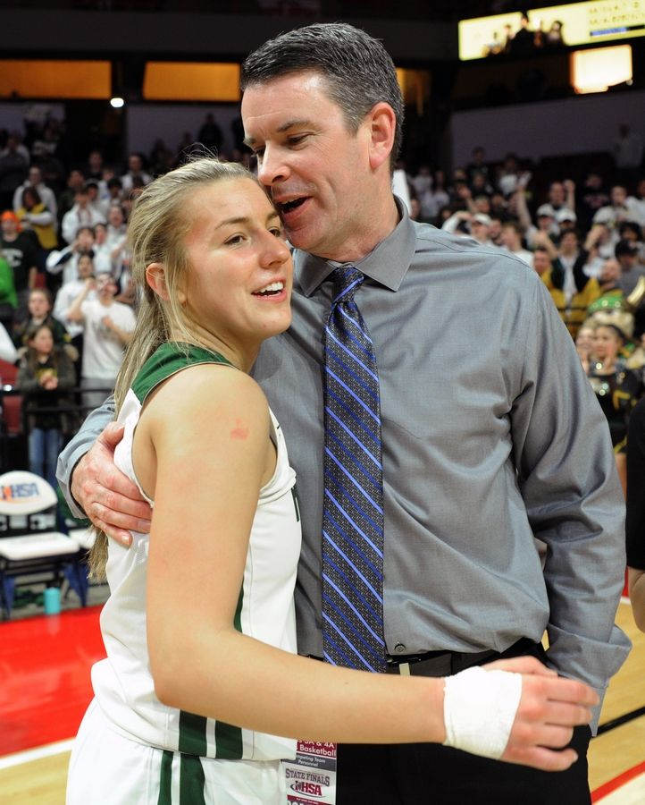 Mark Welsh/mwelsh@dailyherald.comFremd's Emily Klaczek is congratulated by coach David Yates after beating Lincoln-Way West in the 4A girls state basketball championship game in Normal on Saturday.