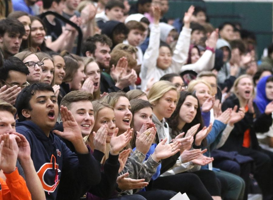 Fremd High School students cheer Monday during a pep rally held at the Palatine school to celebrate the girls basketball team's state championship.