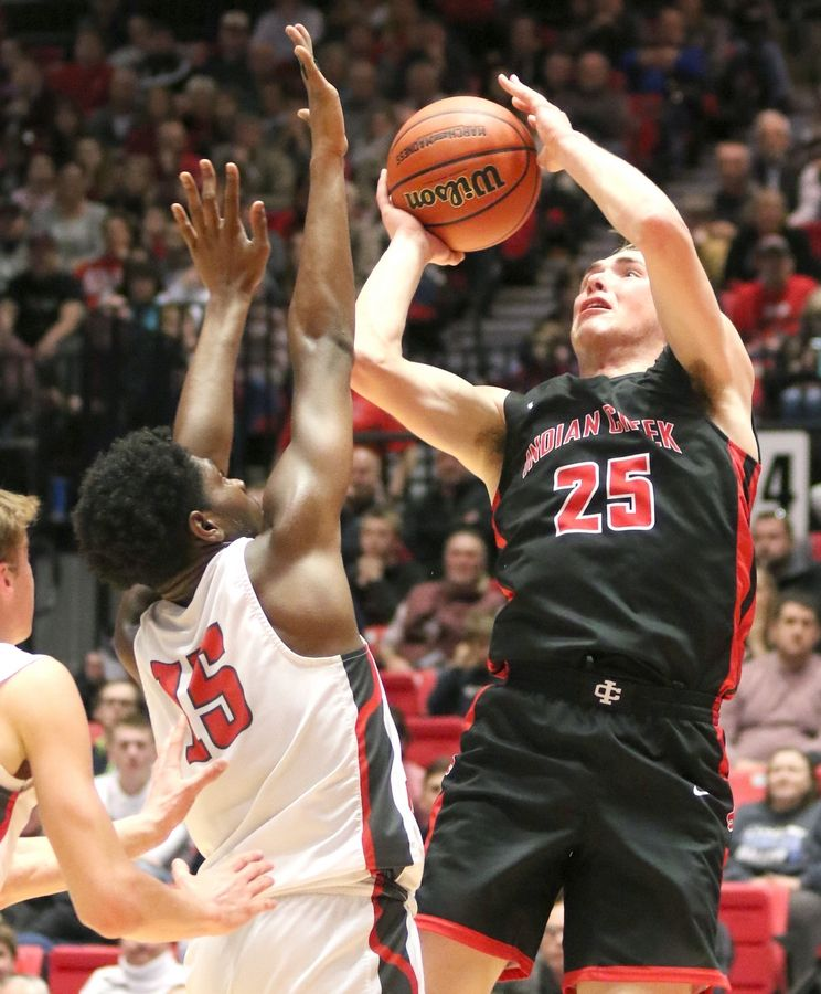 Indian Creek senior Cooper Larsen shoots over Aurora Christian sophomore Jabari Sisco Tuesday during their IHSA Class 1A DeKalb (NIU) Super-Sectional in the Convocation Center at Northern Illinois University.
