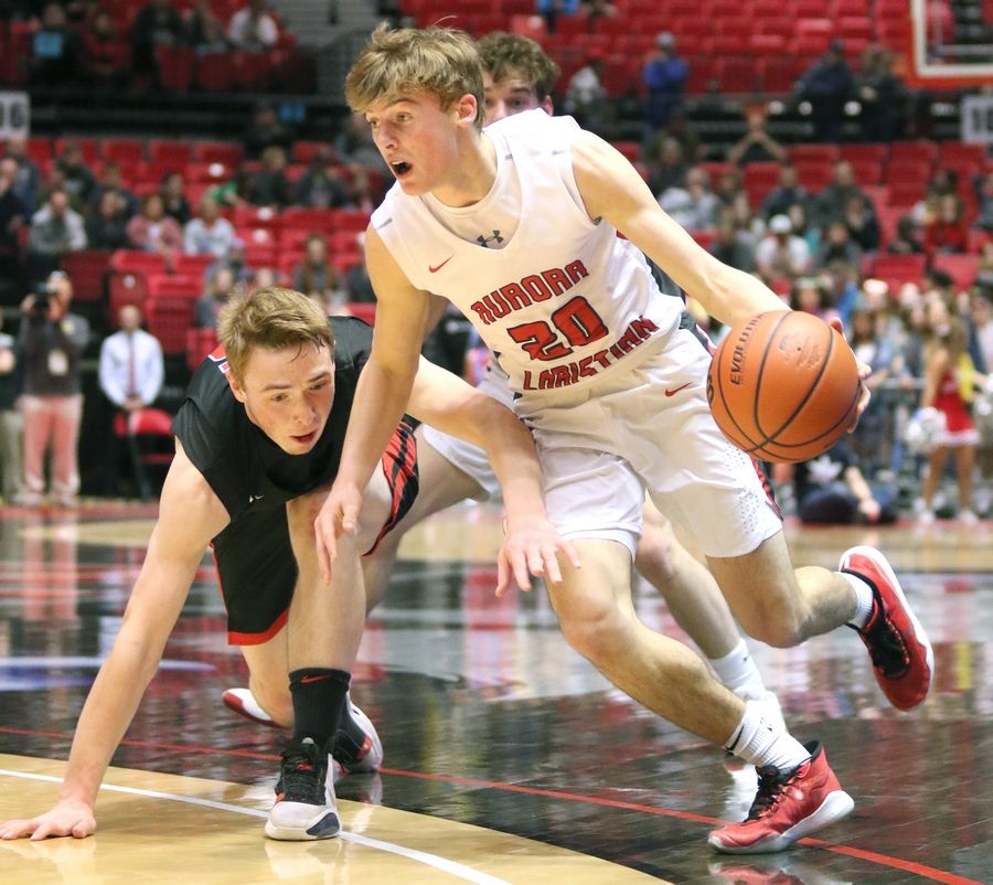 Aurora Christian sophomore Danny New gets by Indian Creek senior Cooper Larson Tuesday during their IHSA Class 1A DeKalb (NIU) Super-Sectional in the Convocation Center at Northern Illinois University.