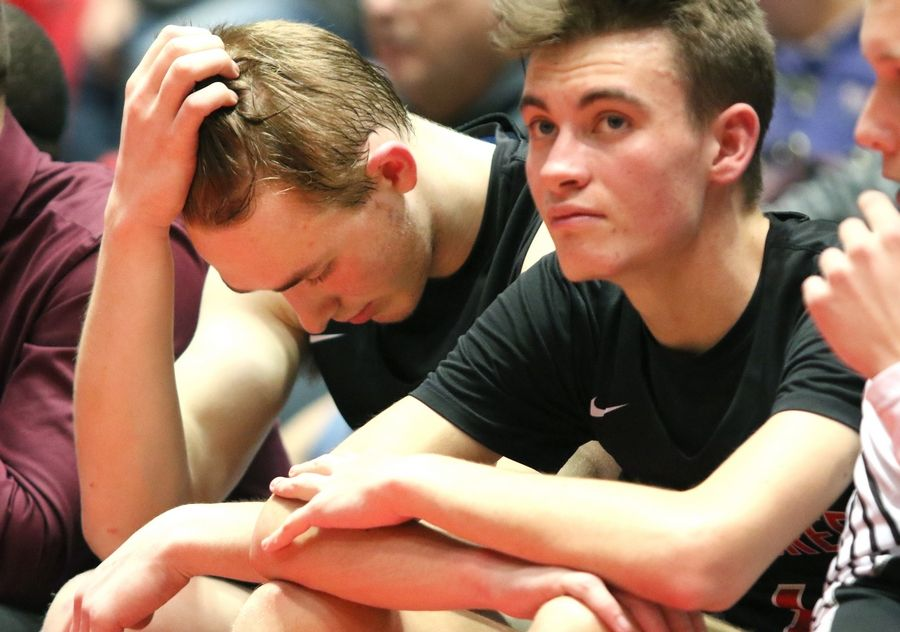Indian Creek's Cooper Larsen (left) and Michael Lampson as time ticks away in their loss to Aurora Christian Tuesday during their IHSA Class 1A DeKalb (NIU) Super-Sectional in the Convocation Center at Northern Illinois University.