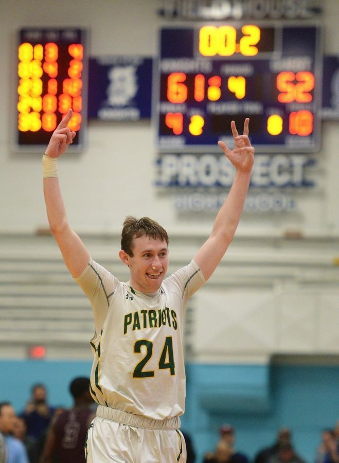 Stevenson's Matthew Ambrose celebrates the Patriots' 61-52 victory over Zion-Benton during game one of the Prospect boys basketball sectional semifinal in Mount Prospect Tuesday.