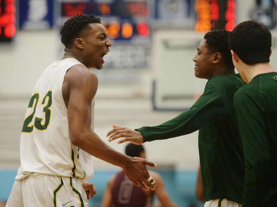 Stevenson's Robert Holmes, left, celebrates a basket and a foul during the Prospect boys basketball sectional semifinal against Zion-Benton in Mount Prospect Tuesday.