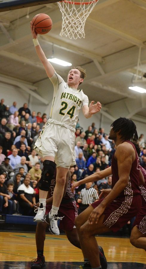 Stevenson's Matthew Ambrose drives to the basket for a layup against Zion-Benton during game one of the Prospect boys basketball sectional semifinal in Mount Prospect Tuesday.