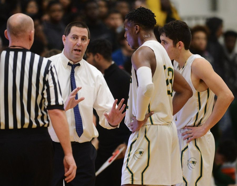Stevenson coach Pat Ambrose asks an official about a call during game one of the Prospect boys basketball sectional semifinal against Zion-Benton in Mount Prospect Tuesday.