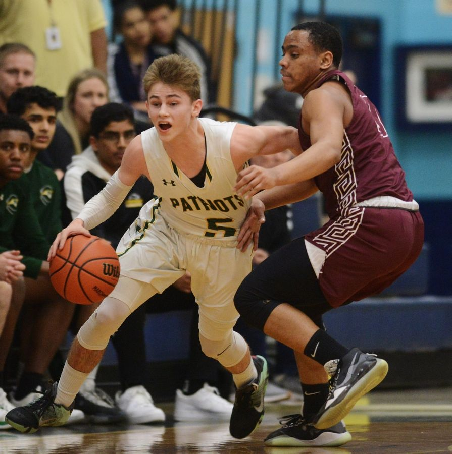 Stevenson's Evan Ambrose dribbles past Zion-Benton's Mikhael Taylor during game one of the Prospect boys basketball sectional semifinal in Mount Prospect Tuesday.
