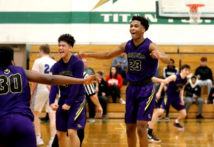 Donovan Carter, right, and Benjamin Chung of Wauconda celebrate a win over St. Francis in Class 3A Rockford Boylan boys basketball sectional semifinal action Tuesday night.