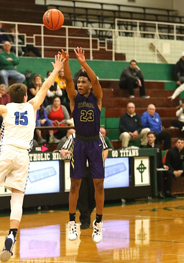 Donovan Carter of Wauconda nails a late 3-pointer to break a tie at 64 during a win over St. Francis in Class 3A Rockford Boylan boys basketball sectional semifinal action Tuesday night.