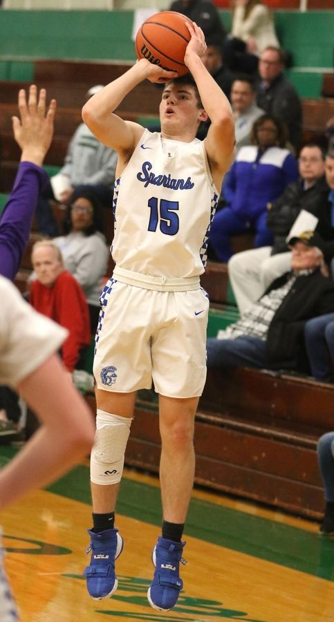 St. Francis' Brendan Yarusso shoots a three-point basket against Wauconda in Class 3A Rockford Boylan boys basketball sectional semifinal action Tuesday night.
