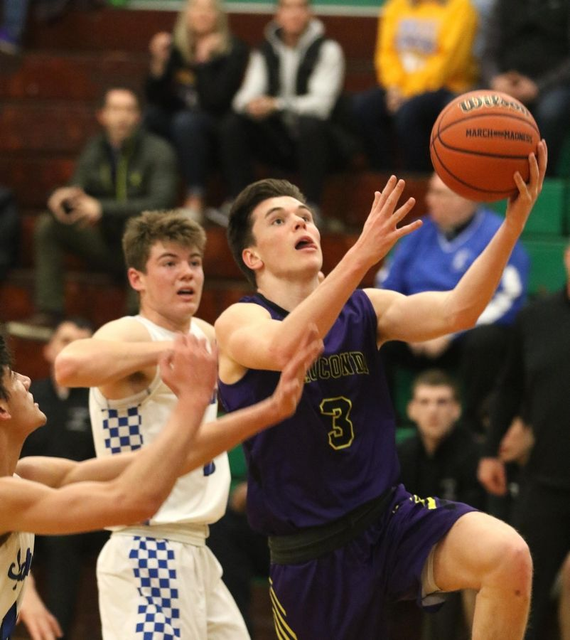 Wauconda's Nicholas Bulgarelli lays the ball up against St. Francis in Class 3A Rockford Boylan boys basketball sectional semifinal action Tuesday night.