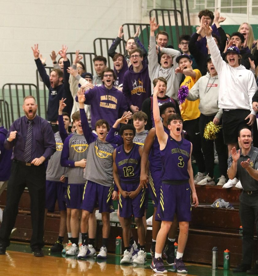 The Bulldogs of Wauconda get revved up as they take their first lead of the game against St. Francis in Class 3A Rockford Boylan boys basketball sectional semifinal action Tuesday night.