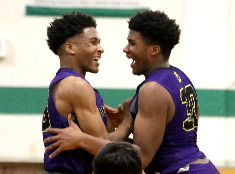 Donovan Carter, left, and Garrison Carter leap for joy as Wauconda celebrates a win over St. Francis in Class 3A Rockford Boylan boys basketball sectional semifinal action Tuesday night.