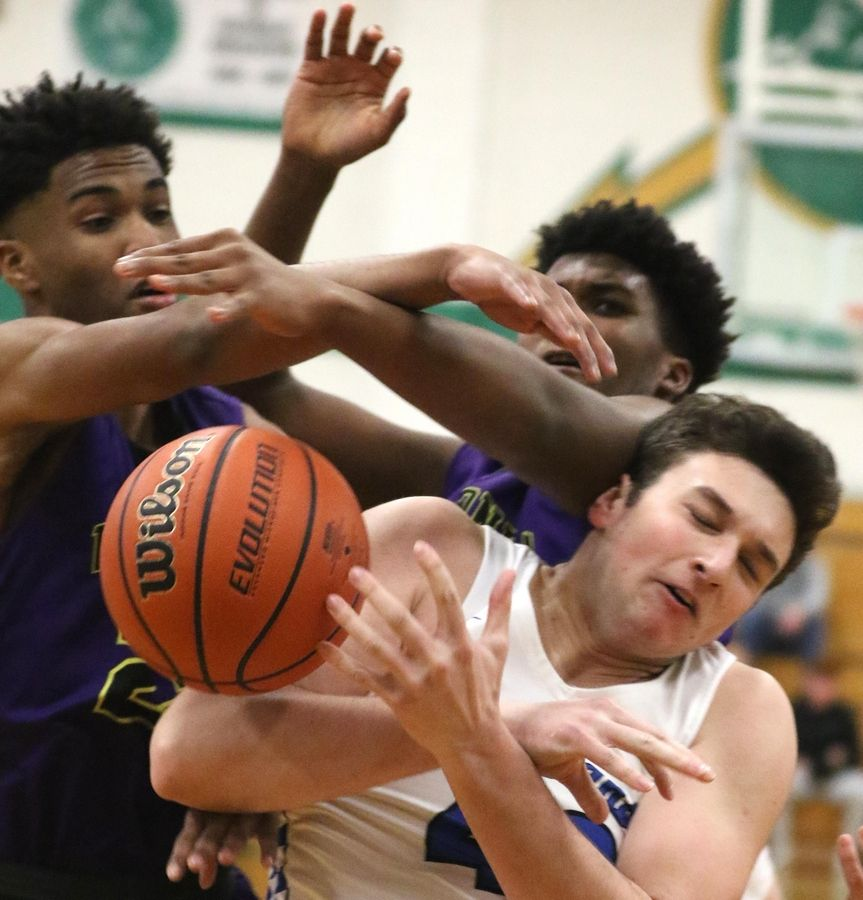 Wauconda's Donovan Carter, upper left, and Garrison Carter, upper right, battle St. Francis' Bryce Walker for the ball in Class 3A Rockford Boylan boys basketball sectional semifinal action Tuesday night.