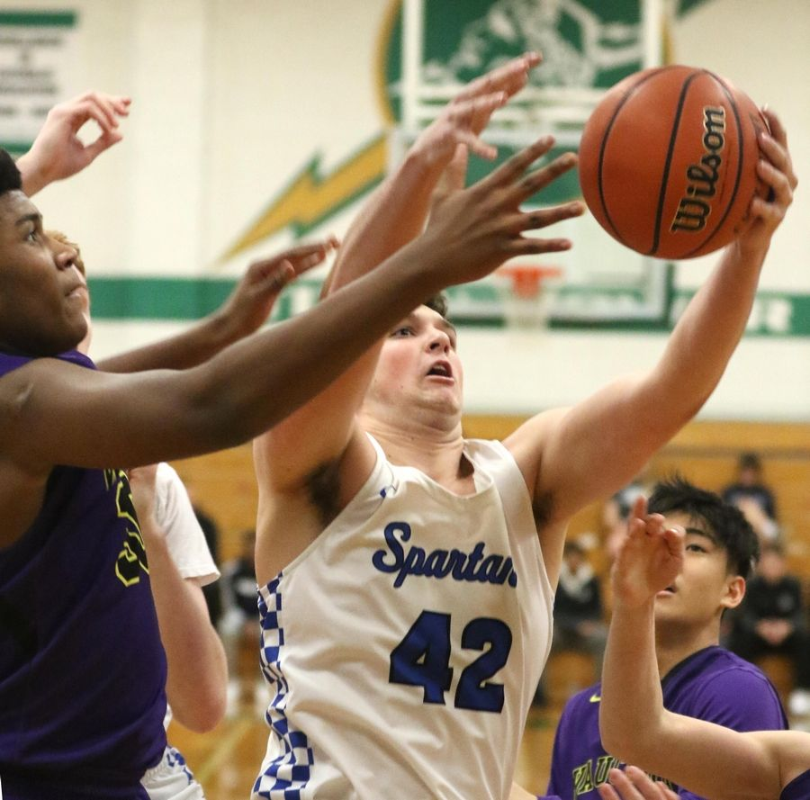 Wauconda's Garrison Carter, left, challenges St. Francis' Bryce Walker for a rebound in Class 3A Rockford Boylan boys basketball sectional semifinal action Tuesday night.