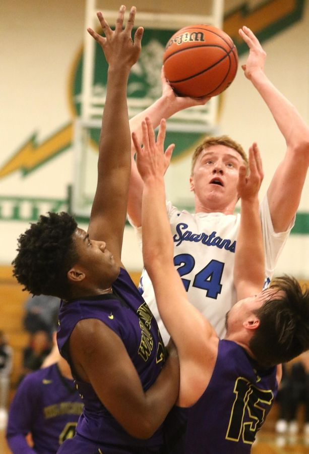 St. Francis' Robert Nocek shoots the ball in heavy traffic against Wauconda in Class 3A Rockford Boylan boys basketball sectional semifinal action Tuesday night.