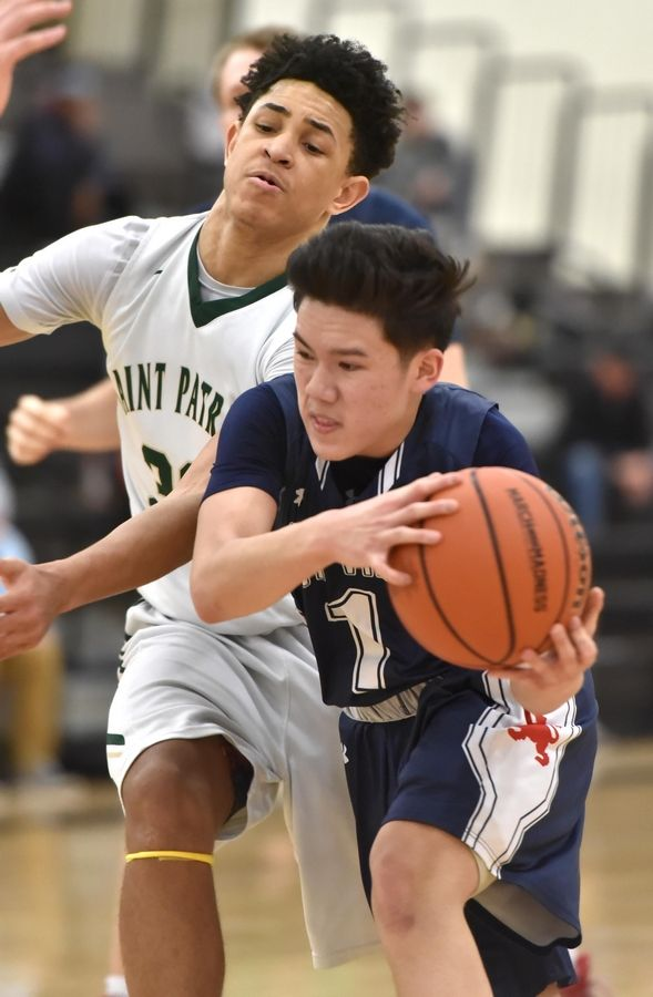 St. Viator's Eli Aldana gets past St. Patrick's Timaris Brown in a Class 3A sectional semifinal boys basketball game in Grayslake Wednesday.