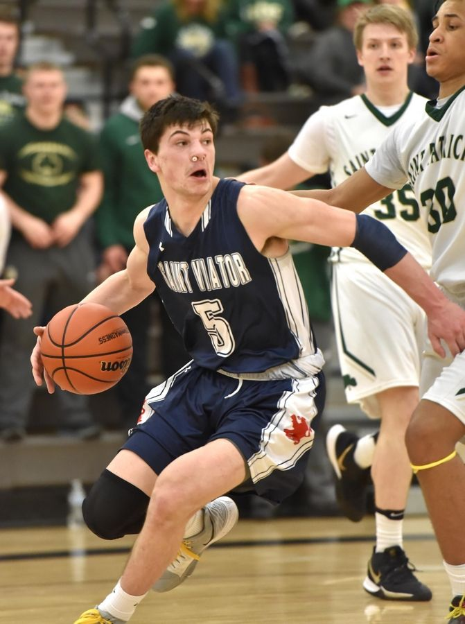 St. Viator's Michael Campagna looks for room against St. Patrick in a Class 3A sectional semifinal boys basketball game in Grayslake Wednesday.