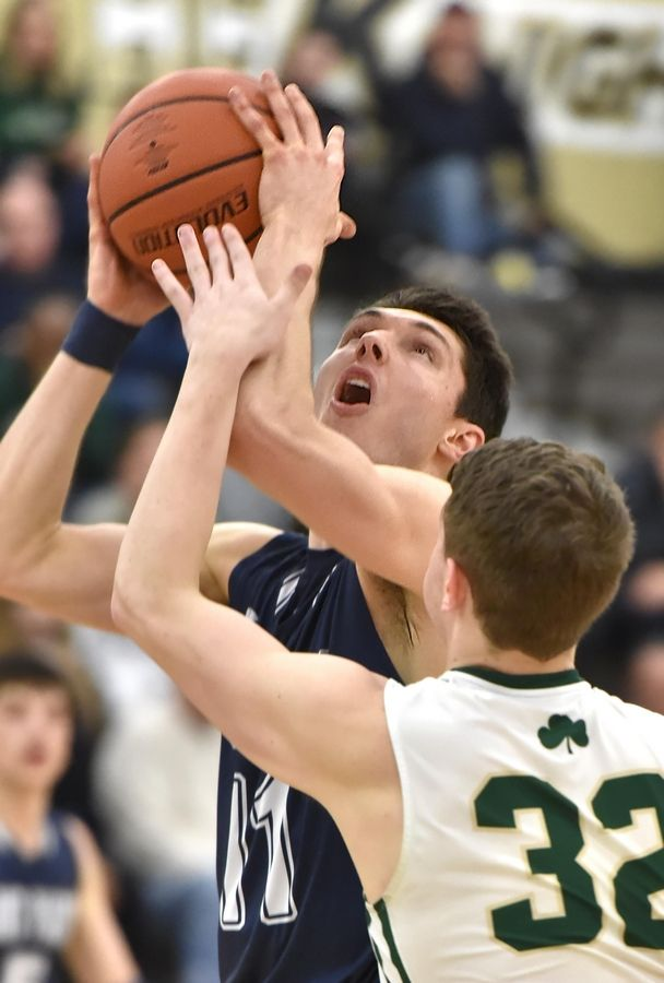 St. Viator's Connor Kochera shoots against St. Patrick's Nick Cioffi in a Class 3A sectional semifinal boys basketball game in Grayslake Wednesday.