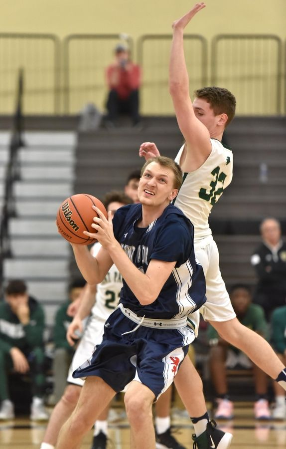 St. Viator's Matt Geary makes a move to get around St. Patrick's Nick Cioffi in a Class 3A sectional semifinal boys basketball game in Grayslake Wednesday.