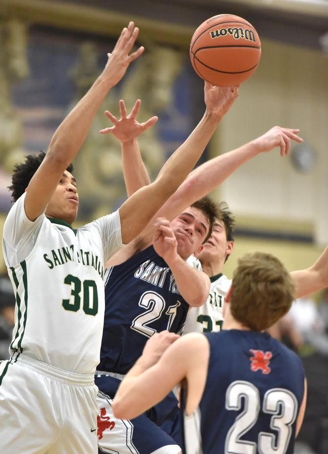 St. Viator's Jack Mahoney battles St. Patrick's Timaris Brown for a rebound in a Class 3A sectional semifinal boys basketball game in Grayslake Wednesday.