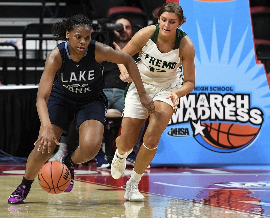 Lake Park's Darrione Rogers heads down court after stealing the ball from Fremd's Olivia Hill in the Class 4A state girls basketball semifinals in Normal on Friday.