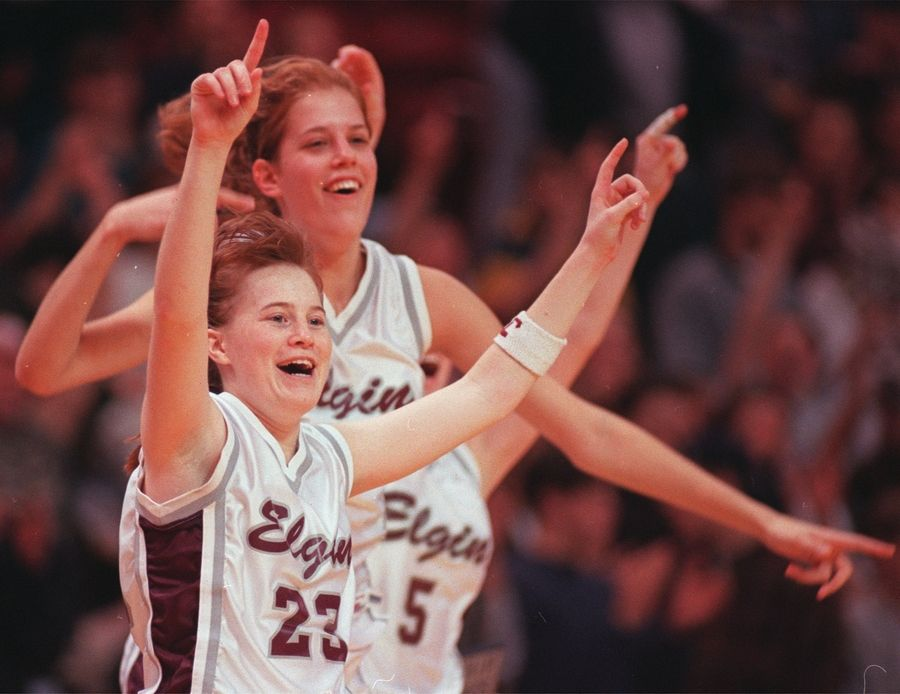 Elgin's Melissa Parker, front, and Leslie Schock celebrate during the IHSA state tournament at Redbird Arena in Normal the weekend of March 1, 1996.