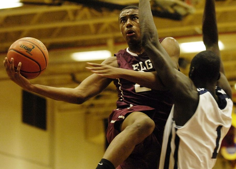 Elgin's Kory Brown drives past La Lumiere's Obij Aget during the championship game of the 2011 Elgin Holiday Tournament.