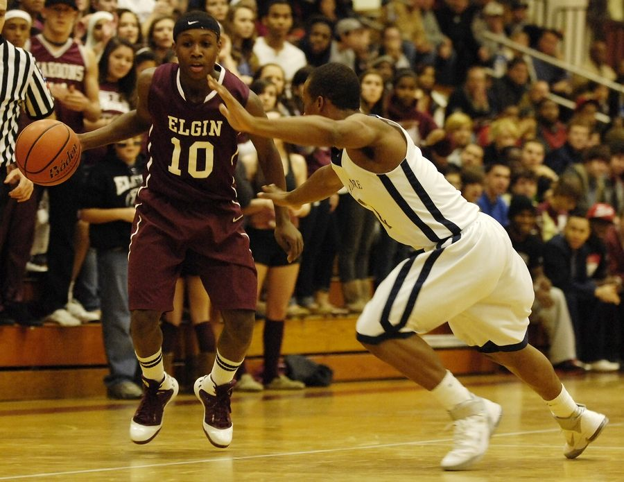 Elgin's Arie Williams drives past La Lumiere's Antonio Drummond during the championship game of the 2011 Elgin Holiday Tournament.