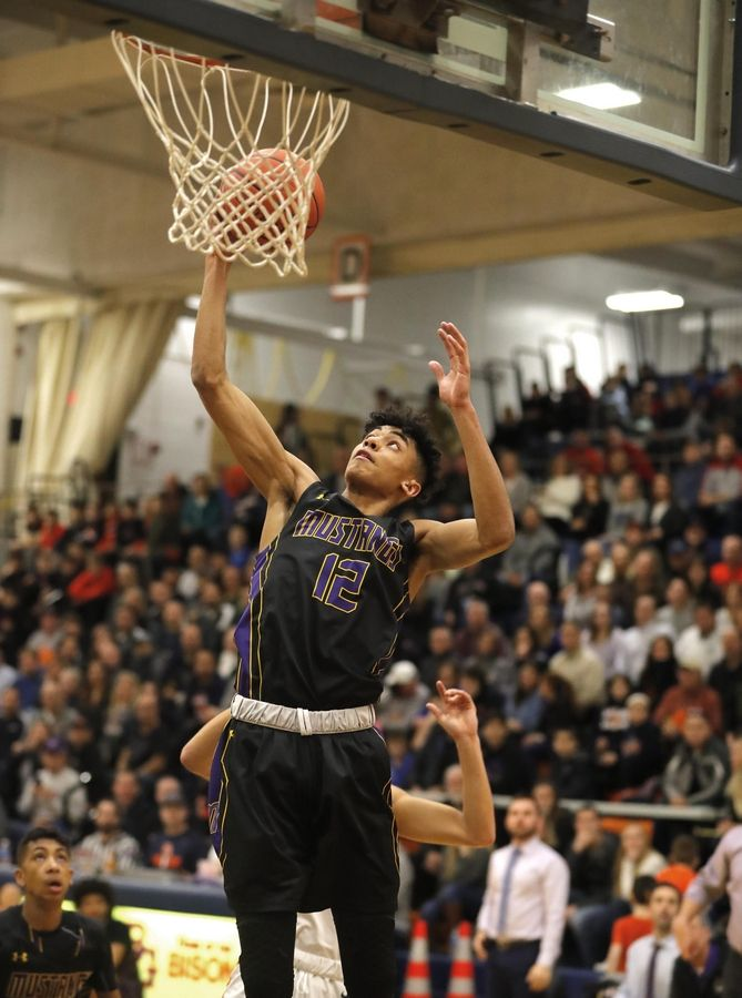 Rolling Meadows' Max Christie snags a rebound against Buffalo Grove on Feb. 7, 2020 in a double-overtime game won by Meadows 93-83. Christie scored 42 points in the win.