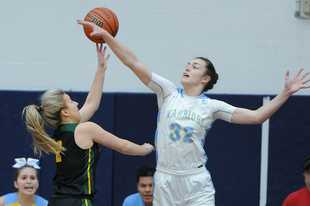 Maine West's Angela Dugalic goes up against Fremd's Emily Klaczek in the girls basketball supersectional at Hoffman Estates in early March. Both players were expected to be invited to the IBCA All-Star Game in June, which has now been canceled due to the COVID-19 pandemic.