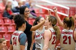 Larkin High School graduate Corry Irvin talks to her Saint Xavier women's basketball team. In her first season at the helm, the Cougars went 29-4 and advanced to the NAIA National Tournament, where their season ended up being canceled due to the COVID-19 pandemic.