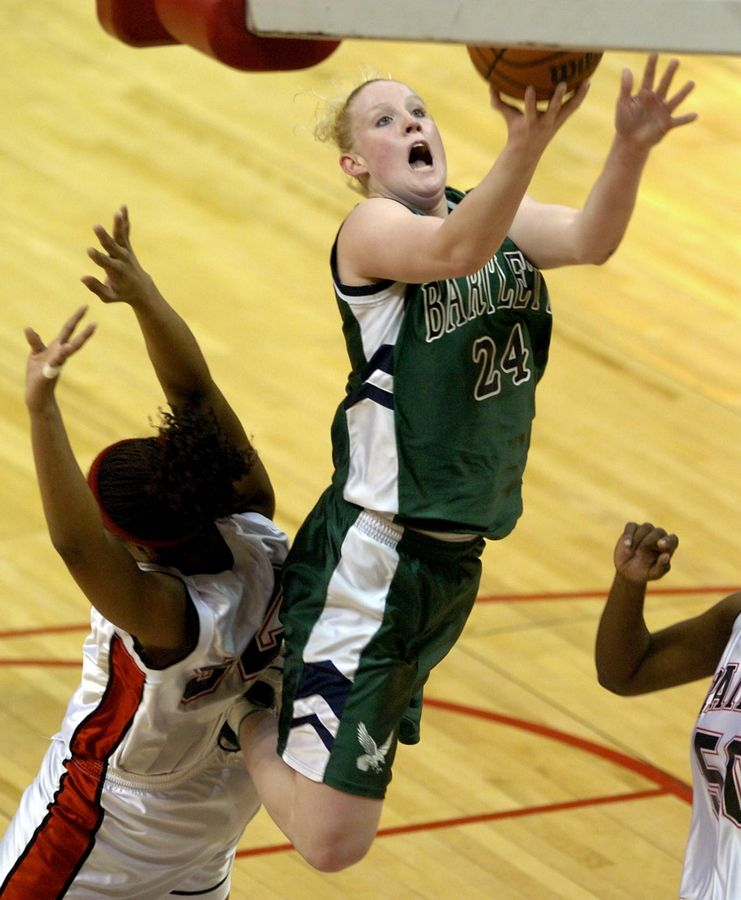 Lindsay Schrader scoops in a basket during a win over Bolingbrook in the 2005 Class AA semifinals. She scored over 2,400 points at Bartlett before a stellar career at Notre Dame.