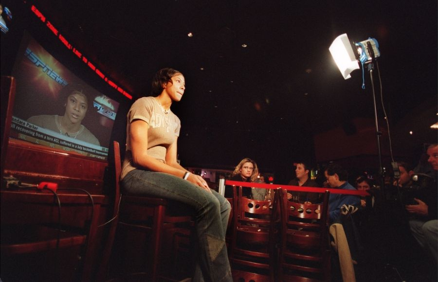 Naperville Central's player Candace Parker does a live interview on ESPN news as she announces Tennessee as her college choice at a news conference held at ESPN Zone in Chicago in 2003.