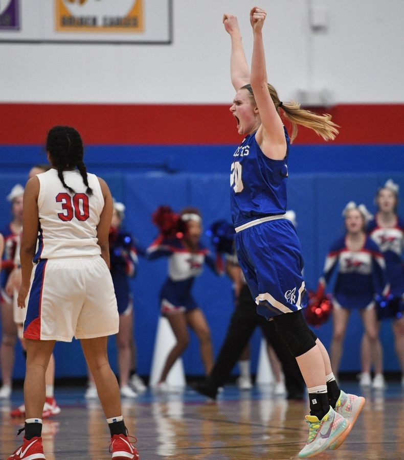 Burlington Central's Kathryn Schmidt, this year's Fox Valley Female Athlete of the Year, celebrates after her game-winning 3-point shot at the buzzer to beat FVC champion Dundee-Crown in Carpentersville.