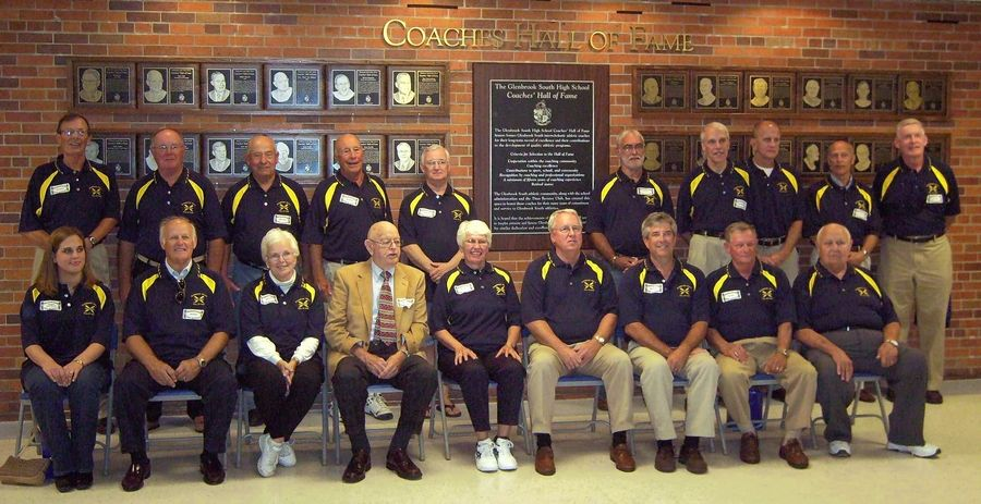 Hall of Fame girls basketball coach Howard Romanek, fourth from the right in the back row, led the Glenbrook South High School Titans to the 1994 Class AA state title.