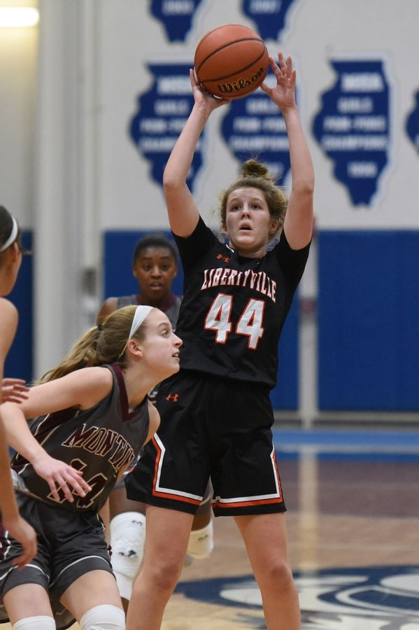 Libertyville's Lauren Huber takes a shot over Montini's Shannon Blacher during action last season.
