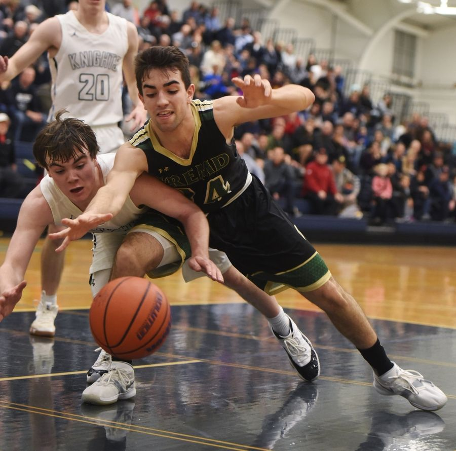 Prospect's TJ Johannesen and Fremd's Tim Carlisle dive for a loose ball during the Mid-Suburban League championship game in Mount Prospect last season. Basketball teams across the state are hoping to hear about the fate of the 2020-2021 season Wednesday.