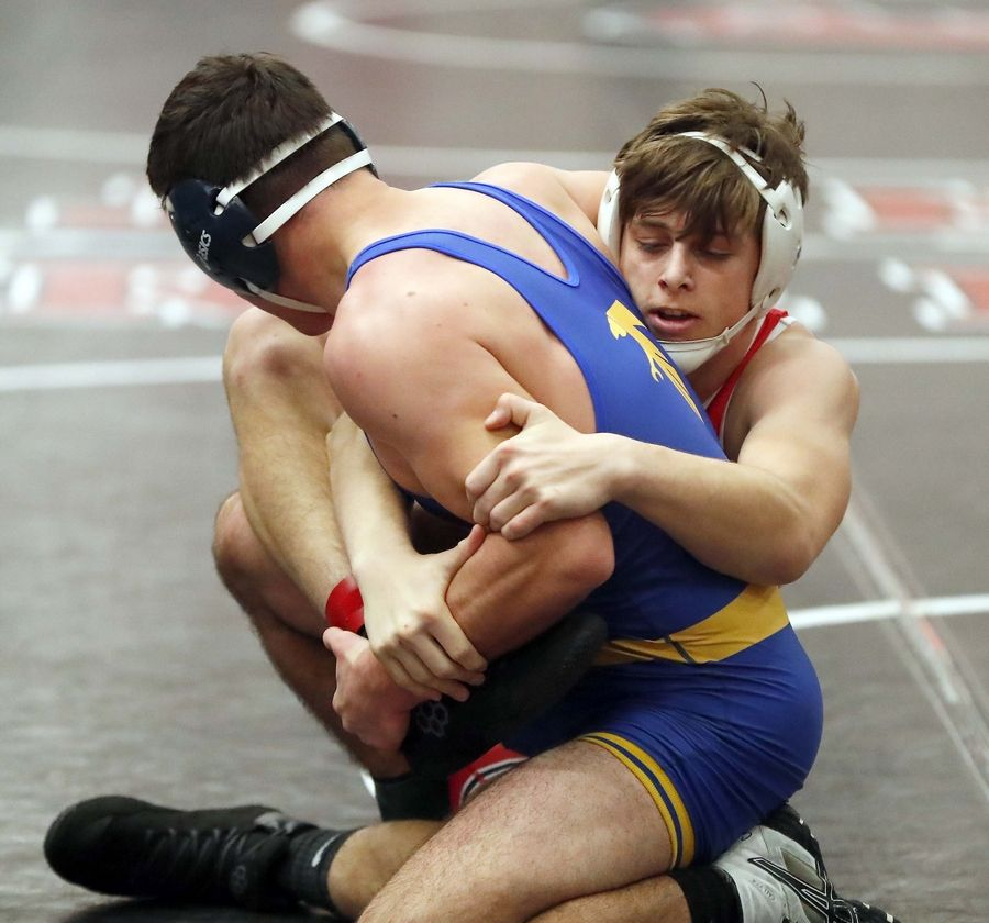 Ethan Geist of Grant (right) wrestles Nathan Love of Wheaton North last season.