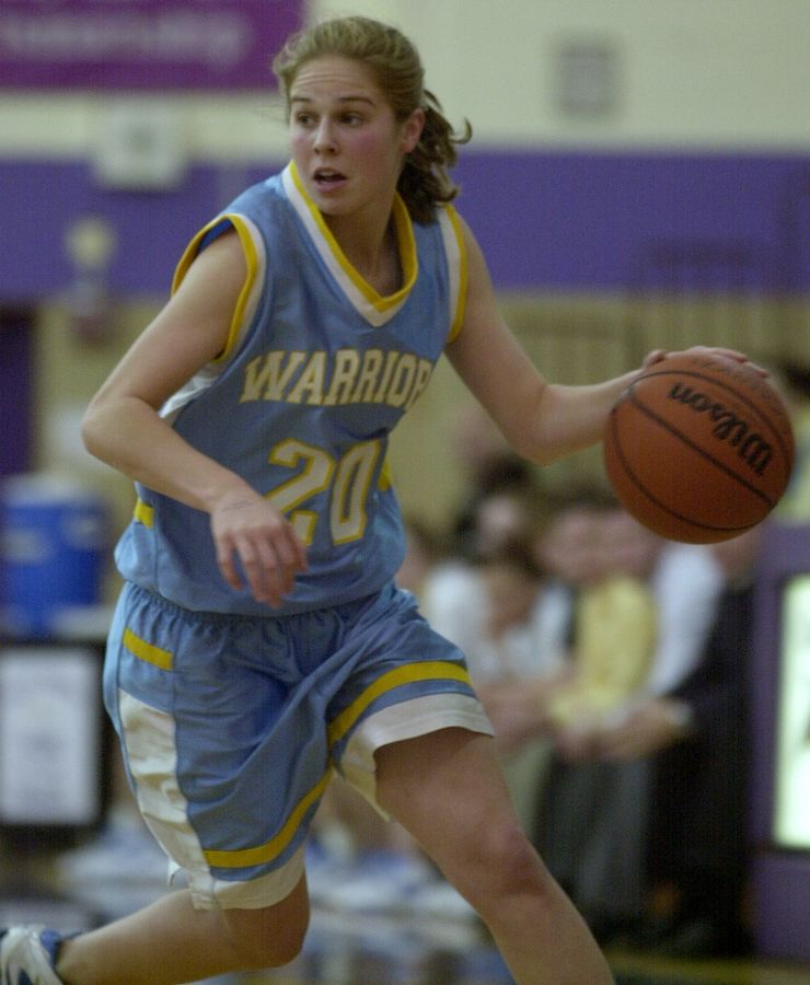 Former Maine West standout Megan Edwards, shown here playing for the Warriors in 2005, will be inducted into the Illinois Basketball Coaches Association Hall of Fame with the Class of 2021.