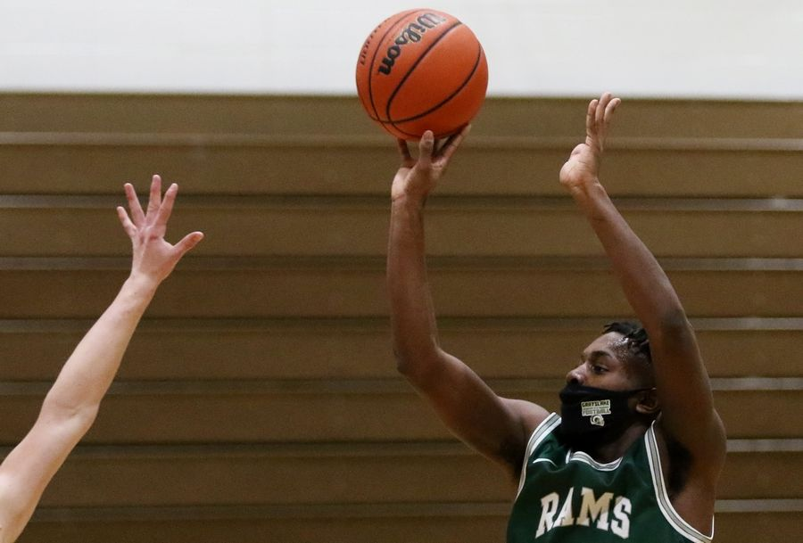 Grayslake Central's Amarion Coleman takes a shot against Crystal Lake South during their boys basketball game at Crystal Lake South High School on Saturday.
