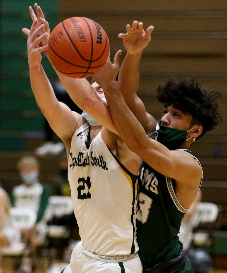 Crystal Lake South's Cooper LePage, left, and Grayslake Central's Shawn Sharma battle over the ball during their boys basketball game at Crystal Lake South High School on Saturday.