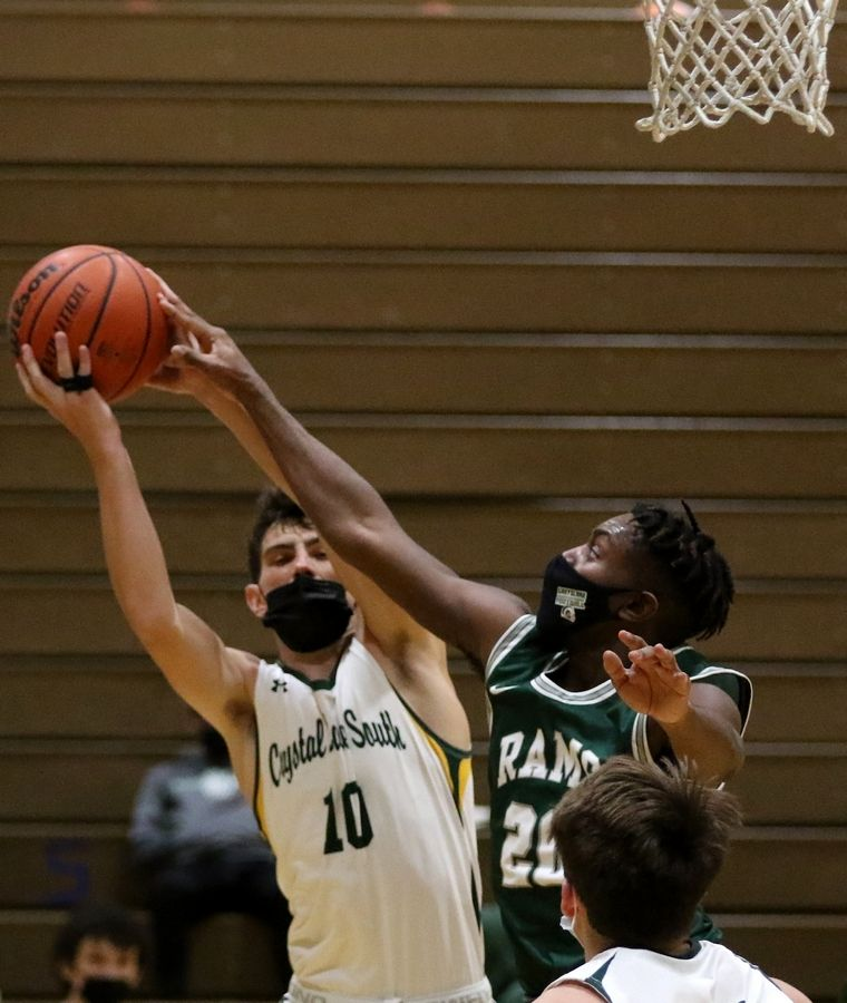 Crystal Lake South's Brock Jewson, left, snags the rebound as Grayslake Central's Amarion Coleman, right, tries to knock it free during their boys basketball game at Crystal Lake South High School on Saturday, Feb. 13, 2021 in Crystal Lake.