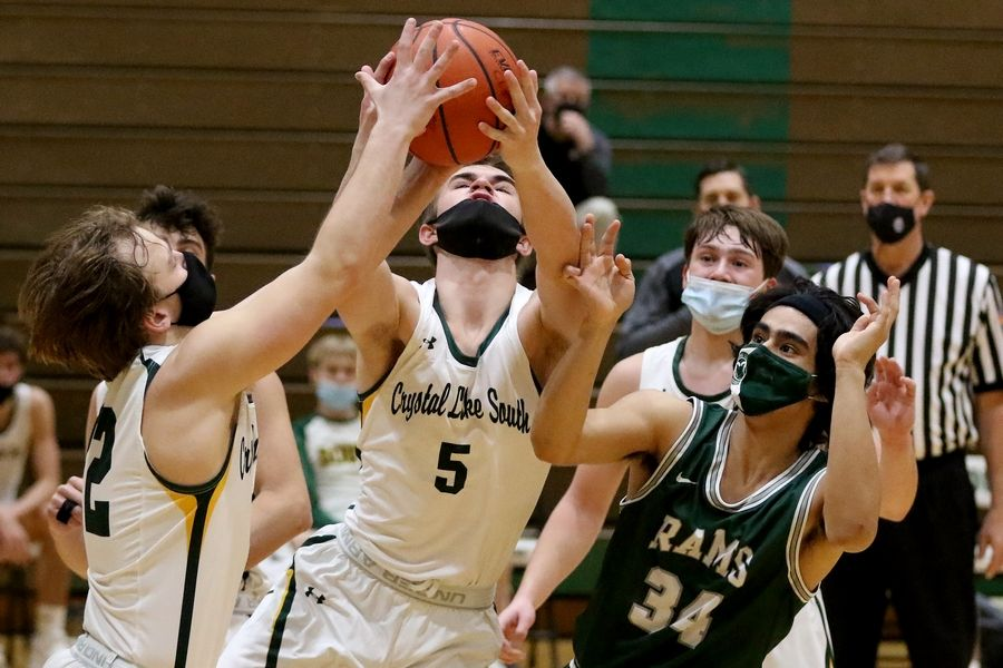 Crystal Lake South's (from left:) Nathan Van Witzenburg, Brock Jewson, Brady Schroeder, and Cooper LePage focus on the rebound with Grayslake Central's Zoel Martinez during their boys basketball game at Crystal Lake South High School on Saturday, Feb. 13, 2021 in Crystal Lake.