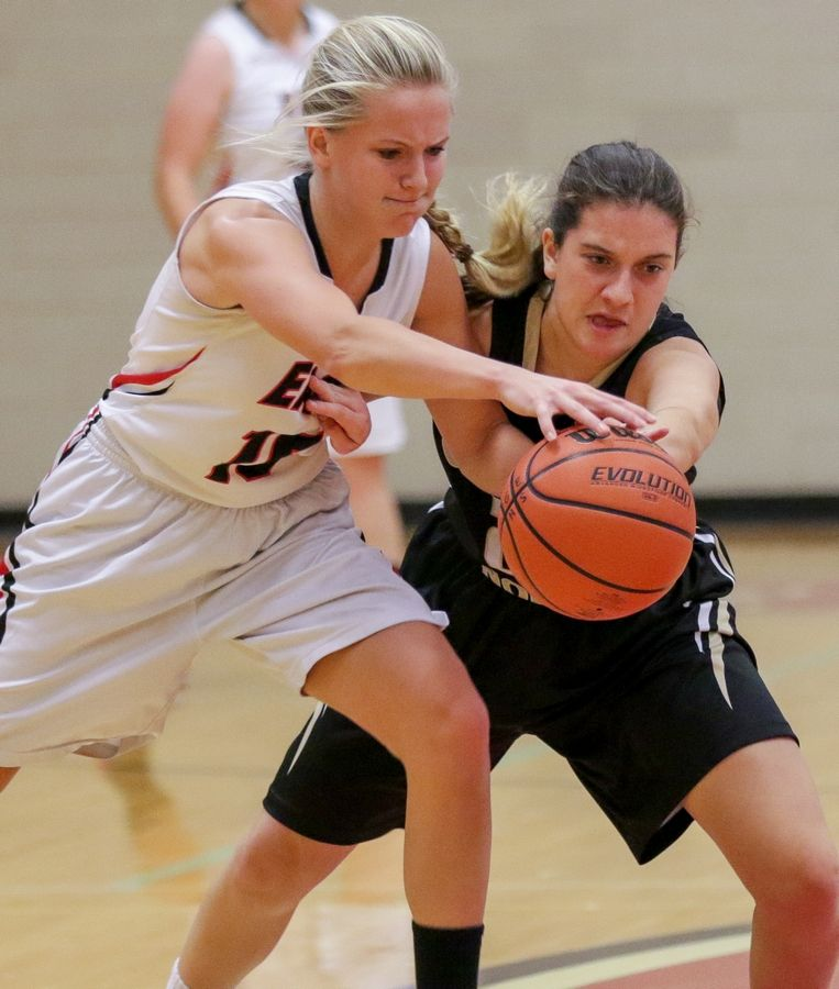 Glenbard East's Lauren Huber, left, recently scored her 1,000th point and is closing in on the school's all-time record.