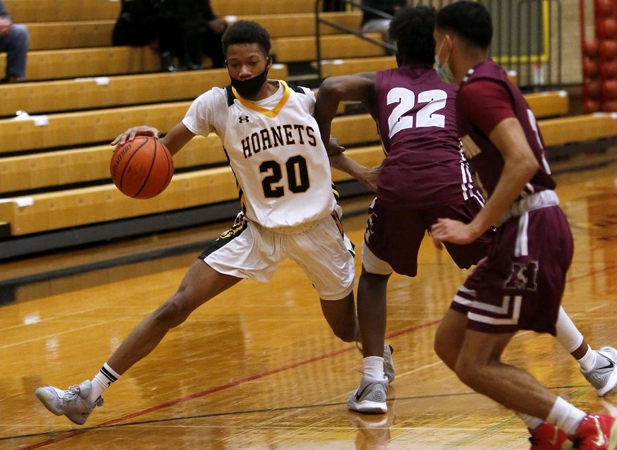 Hinsdale South's Ahmad Tims drives to the basket during their basketball game against Morton at Hinsdale South High School in Darien, Ill., on Friday, Feb. 19, 2021.