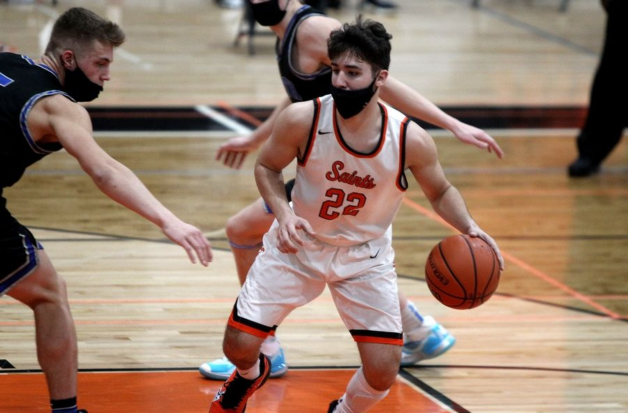 St. Charles East's Matthew Peddy (22) dribbles the ball during a home game against St. Charles North on Saturday, Feb. 20, 2021.
