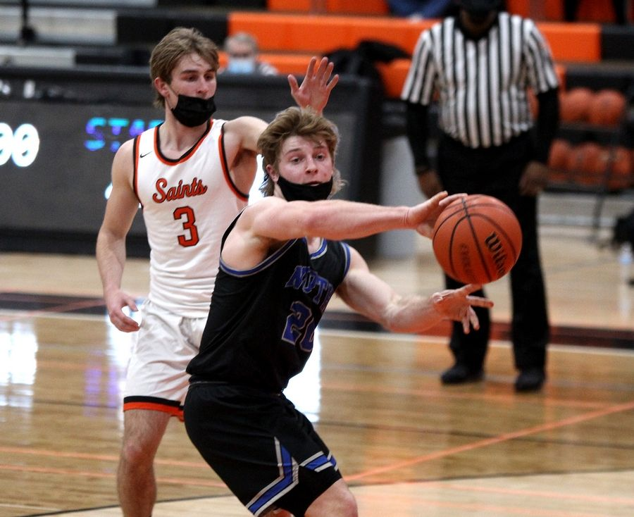 St. Charles North's Nicholas DeMarco passes the ball during a win over St. Charles East Saturday night.