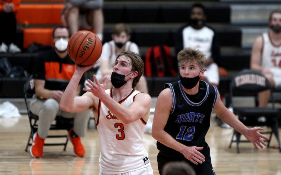 St. Charles East's Joseph Musial (3) puts up a shot during a home game against St. Charles North on Saturday, Feb. 20, 2021.